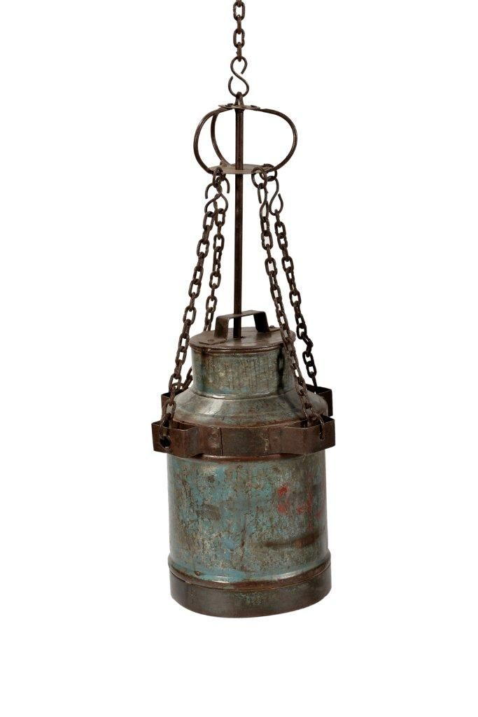 Oude melk kannen er is een lamp van gemaakt