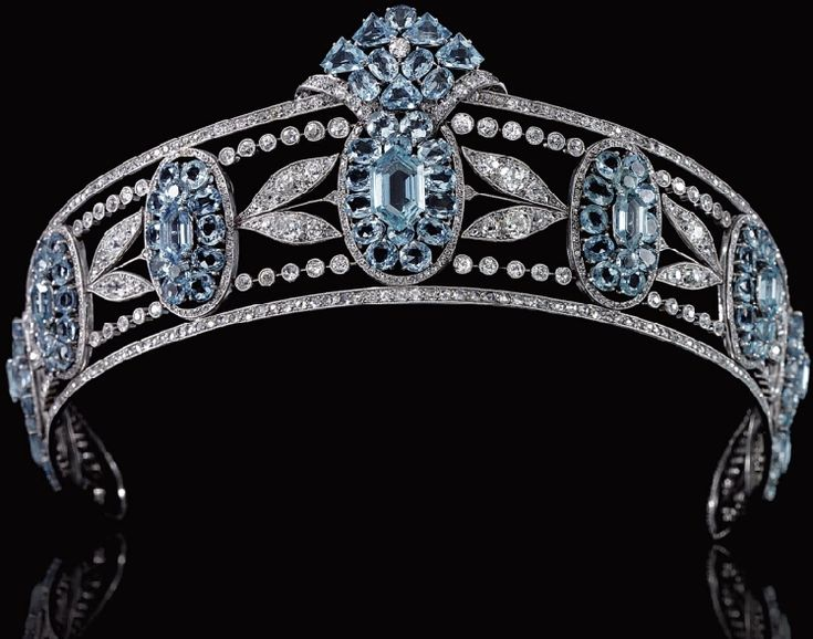BELLE EPOQUE AQUAMARINE AND DIAMOND TIARA, CIRCA 1910  Designed as a series of graduated oval aquamarine clusters set with oval- and hexagonal-shaped aquamarines, interspersed with sprays of diamond myrtle leaves, within millegrain borders of circular-, single- and rose-cut diamonds,  inner circumference approximately 370mm, fitted red leather and gilt tooled case.  Part of the estate of Christian, Lady Hesketh - see Tiara - Hesketh Aquamarine board for more pictures.