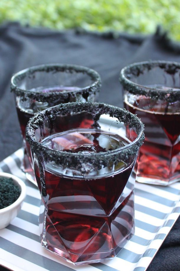 Black ice cubes (made with black food coloring and water) add an extra dash of creepy to this black licorice cocktail delight.
