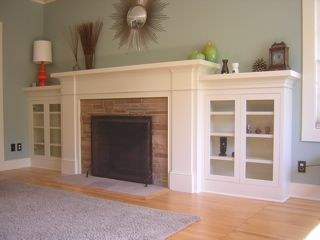 Classic Craftsman fireplace mantel with side cabinets. Like this so much but the stone ledge around would be an issue.