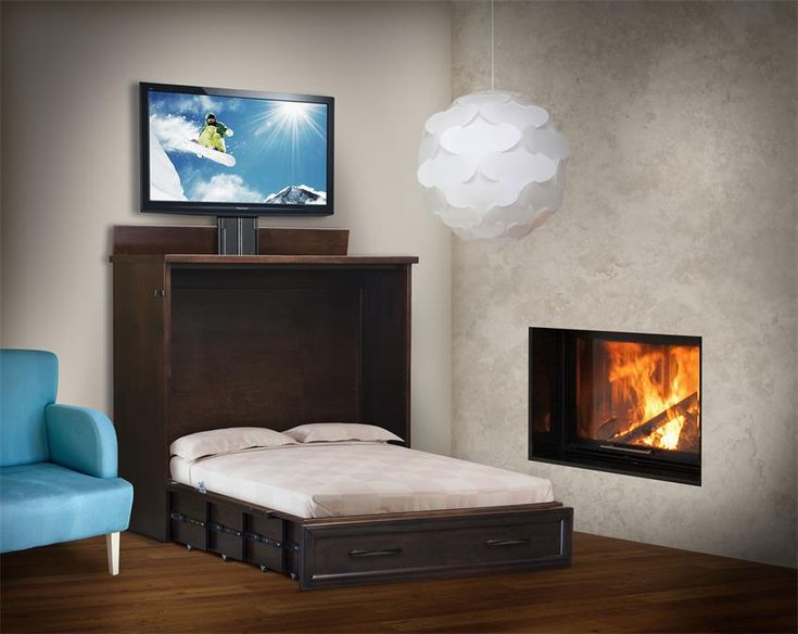 Amish Space Saving Wall Bed with TV Lift Top serves as both an entertainment center and bed for guests.