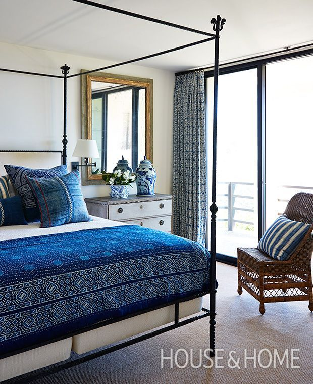 Hits of deep indigo in a variety of patterns keep this California bedroom feeling fresh, while playing off the ocean views. | Photographer: Stacey Brandford | Designer: Bruce Gregga, Stephan Jones