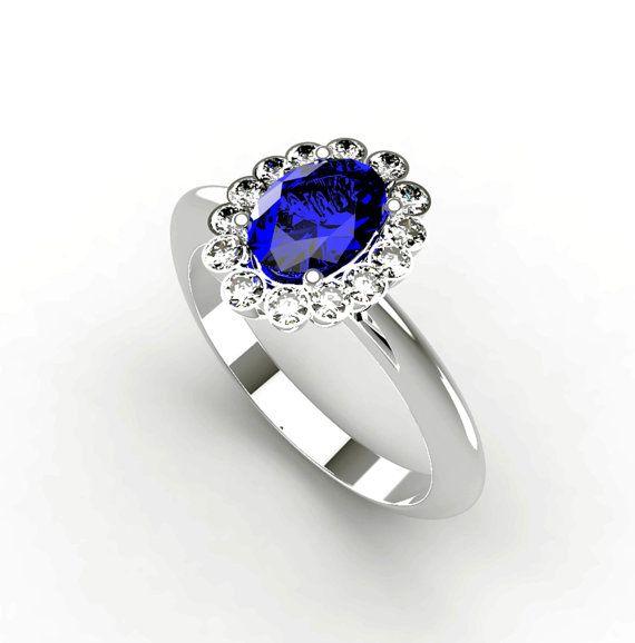 Zaffiro blu, anello di fidanzamento di colore, zaffiro da 0,98 Ct -5x7mm.-contornato da 14 diamanti naturali