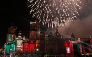 The main event of Independence Day in Mexico is when thousands of people join in the main plaza of Mexico City, the Zocalo. On the evening of September 15, many people come to the square dressed in traditional mexican clothing to join the fiesta. The square is packed with people by 11 p.m. when the President arrives to give the cry of Independence. He then rings the same bell as Father Hidalgo to recreate the moment when he signaled for a revolution. The ceremony ends with a VIVA MEXICO! #3B