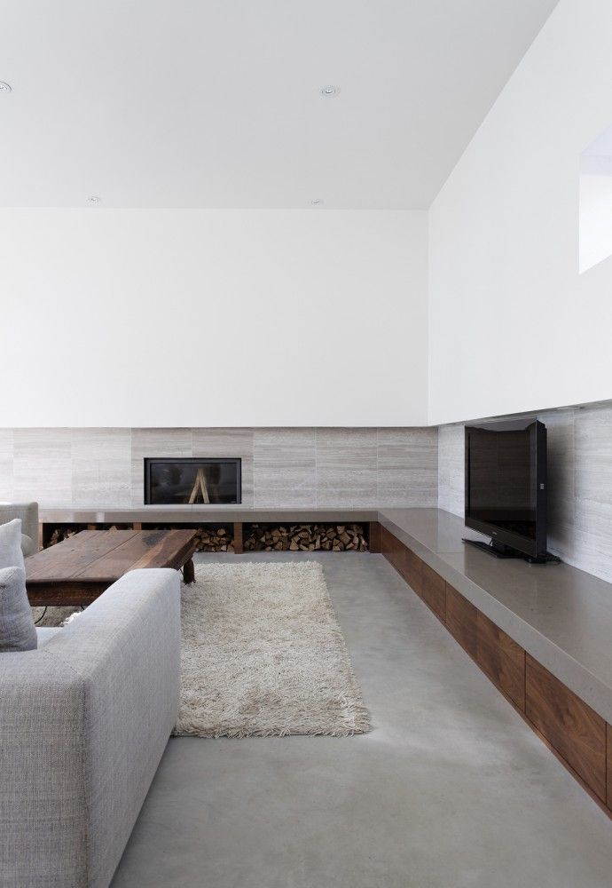 vein cut travertine marble stone feature wall treatment | Carling Residence / Tact Architecture