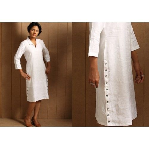 Koylang Linen Dress by Seamstress   PC 16214 This pure white shirt dress in linen has button plackets on the side slits and sleeves. Classic chic with a hint of quirk. Koylang is the Dutch name for the ancient trading town of Kollam in Kerala.