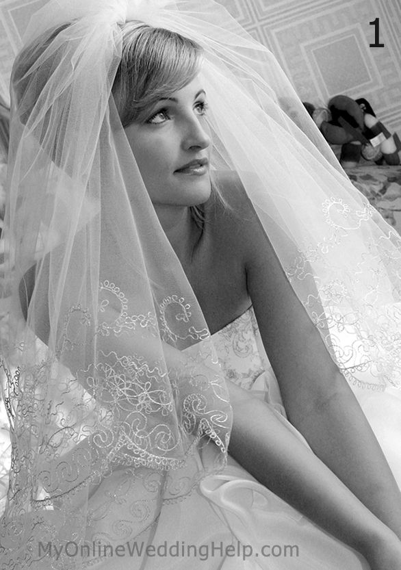 4 popular veil styles. example of center gathered, scallop edge veil worn on top of head.