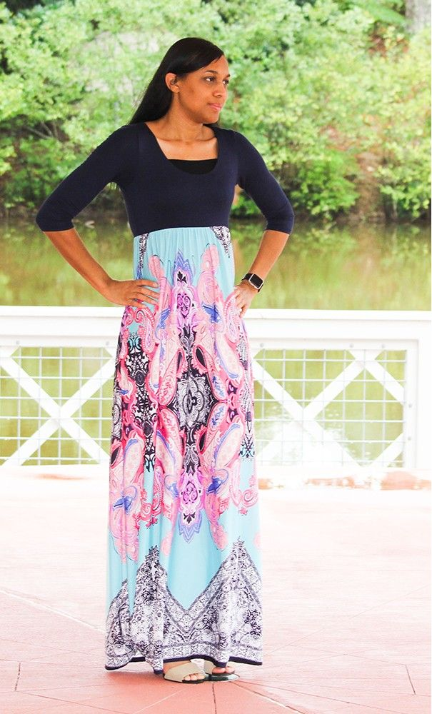 A classy 3/4 sleeve maxi dress with a double lined navy 3/4 sleeve top and a multi-spring print skirt available in S-L