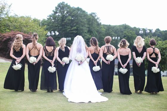 Love. This. Bridesmaids show off the different backs of their long black dresses. | Indian Hills Country Club in GA