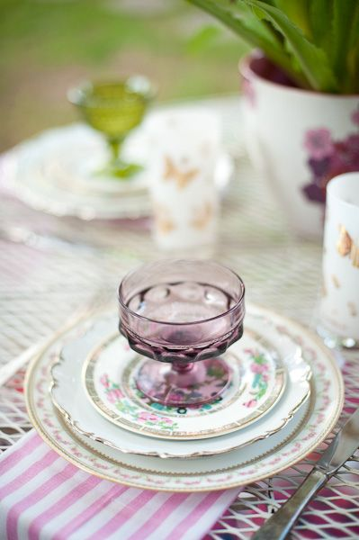 mixed vintage china with an asian flare. love this with the purple footed glass.