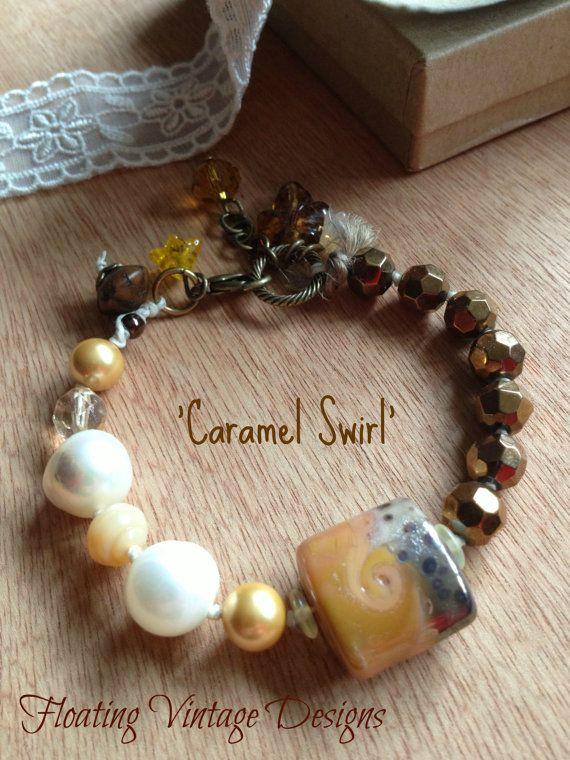 handmade caramel swirl lampwork focal bracelet chocolate brown and cream bracelet beaded bracelet on waxed linen cord