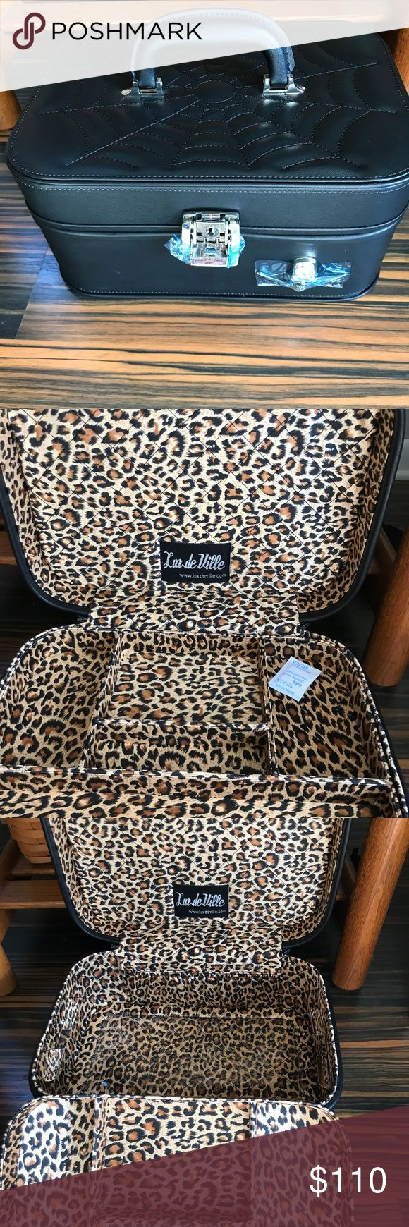 Lux de ville vanity case Brand new Elvira vanity case it is black matte has the spider web stitching on top with skull hardware inside lined with leopard and plastic coded bottom great for the makeup artist or can be used as a jewelry box size is 13 x 9x6 make offers no trades lux de ville Bags Cosmetic Bags & Cases