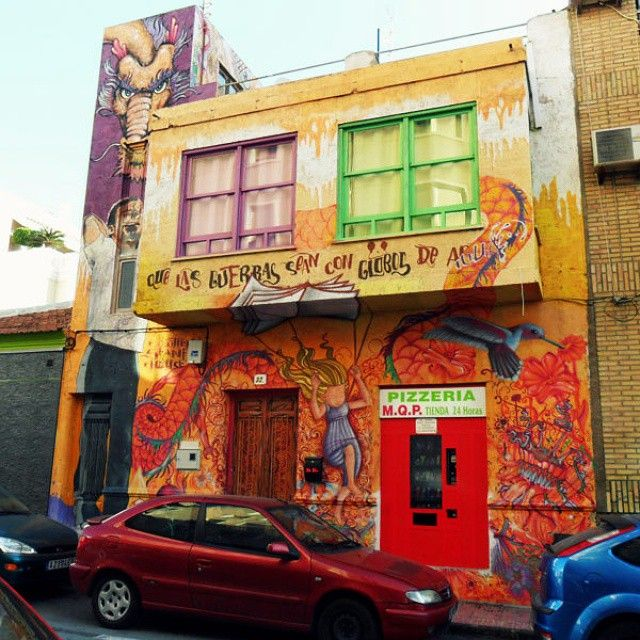 "http://www.gramfeed.com/nancy.gronholm ""Que las guerras sean con globos de agua"" / ""May all wars be water balloon wars"". Decorated façade in Torrevieja, Spain. :)"