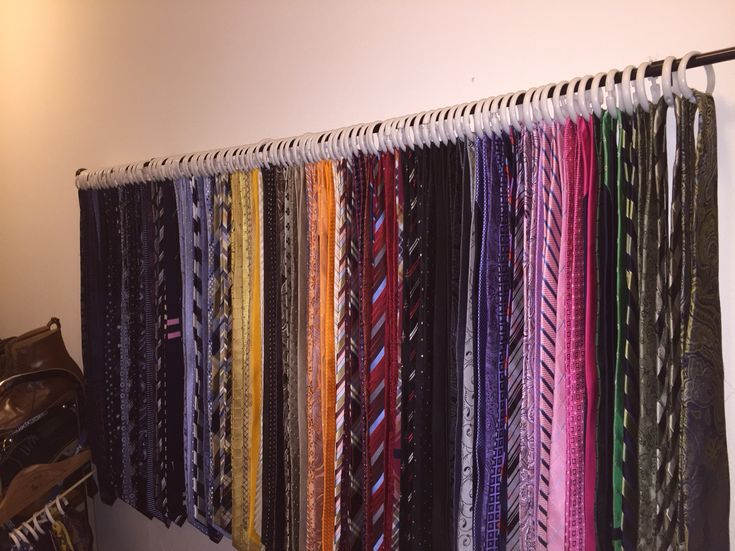 Neck tie storage solution!  Attached a drapery rod to the closet wall and used 12 pack shower clips from the dollar store.  Ties are very easy to take off and place back on.  Could also work for scarves.