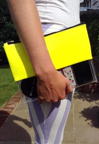 Neon yellow and transparent clutch bag