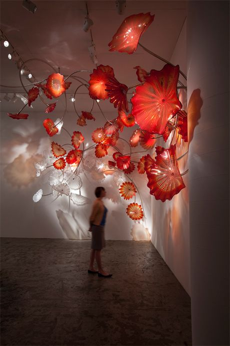 """Chihuly created a spectacular site-specific installation entitled """"Chelsea Persians"""" featuring over one hundred Persian blown glass elements which are open, disc-like forms with striations (called """"body wraps"""")."""