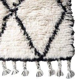 Dit wollen vloerkleed met zwart ruit patroon van HK Living heeft een prachtige moderne en Scandinacische look.<br> - Wol<br> - Zwart, Wit<br> - 180x280cm