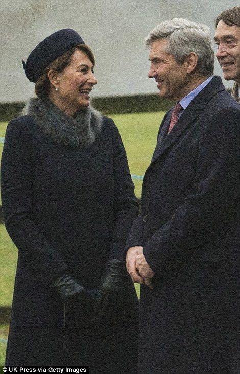 Carole, wore a dark coat with a grey fur trim...