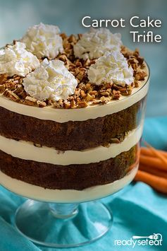 An impressive layered dessert with moist carrot cake, crunchy pecan pieces, and a sweet, tangy cream cheese icing