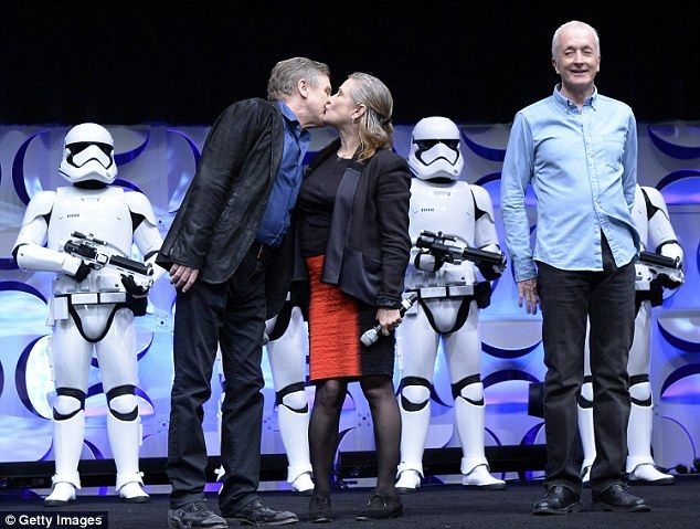 They're back: Hamill is pictured above with Carrie Fisher, who played Princess Leia, and Anthony Daniels, who played C-3PO