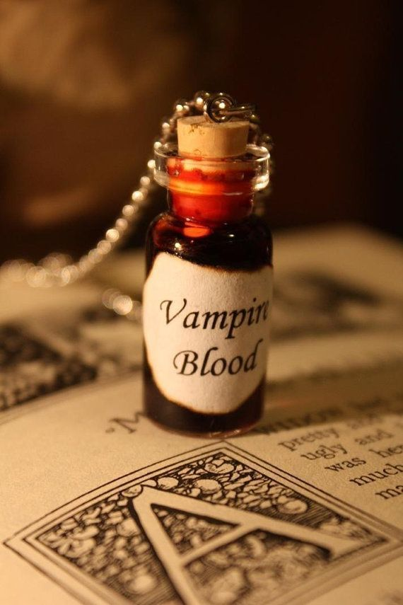This vial reads Vampire Blood with red blood inside. Comes on a 24 inch ball and chain necklace. Glass Vial: stands approximately 1.5 inches tall