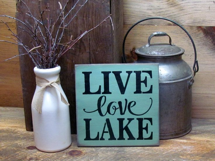 """This wood sign reads """"Live Love Lake"""". It measures approx 8"""" W x 8"""" H It is painted a Tourmaline Green with Wise Owl Chalk Synthesis Paint and has a router back for hanging. All of our signs are paint"""