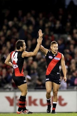 Round 6 - Essendon vs Brisbane  Lonergan and Leroy celebrate a goal - subdued this week!!  (Photo: AFL Media) — at Etihad Stadium.  #afl #essendonfc