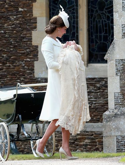 BRITAIN-ROYALS-Kate Middleton, dressed in an Alexander McQueen coat and Jane Taylor hat carrying Princess Charlotte into church