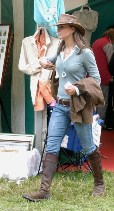 Duchess Catherine in green sweater, jeans, brown boots, and brown hat at Gatcombe Park, August 2005