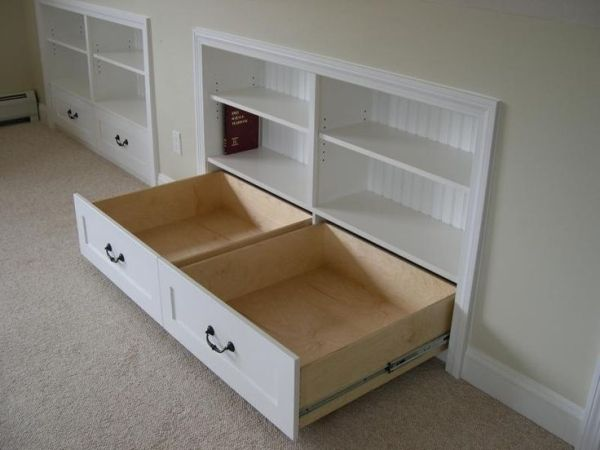 built ins for the upstairs knee walls in the homeschool room....ATTIC?  use slope bottom for drawers.... by TinaVi