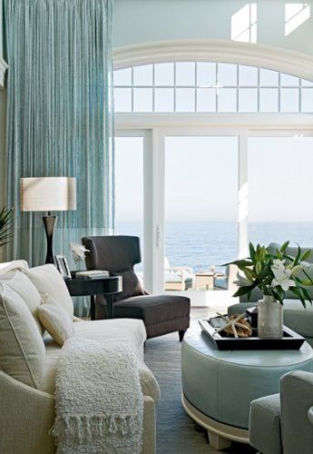 In this seaside home the colors are coastal, a lovely blue/green, appropriate to the ocean setting. Love the window.