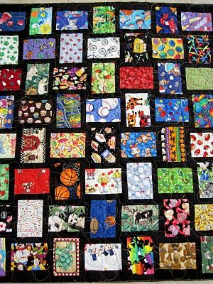 """This I Spy Quilt is made with 4 1/2"""" by 6 1/2"""" blocks sashed on the long side with 1 1/2' by 6 1/2"""" strips, alternate the placement for each block in the row, sew rows together. The sashing forms the frame for each and finish off with 1 1/2"""" boarder all the way around, then add outer boarders to suit."""
