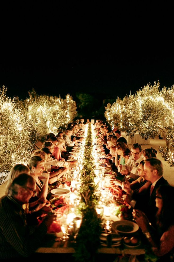 Wedding Trends 2015 | Al Fresco | One very long wedding table with flowers all down the middle and and outdoor lighting.