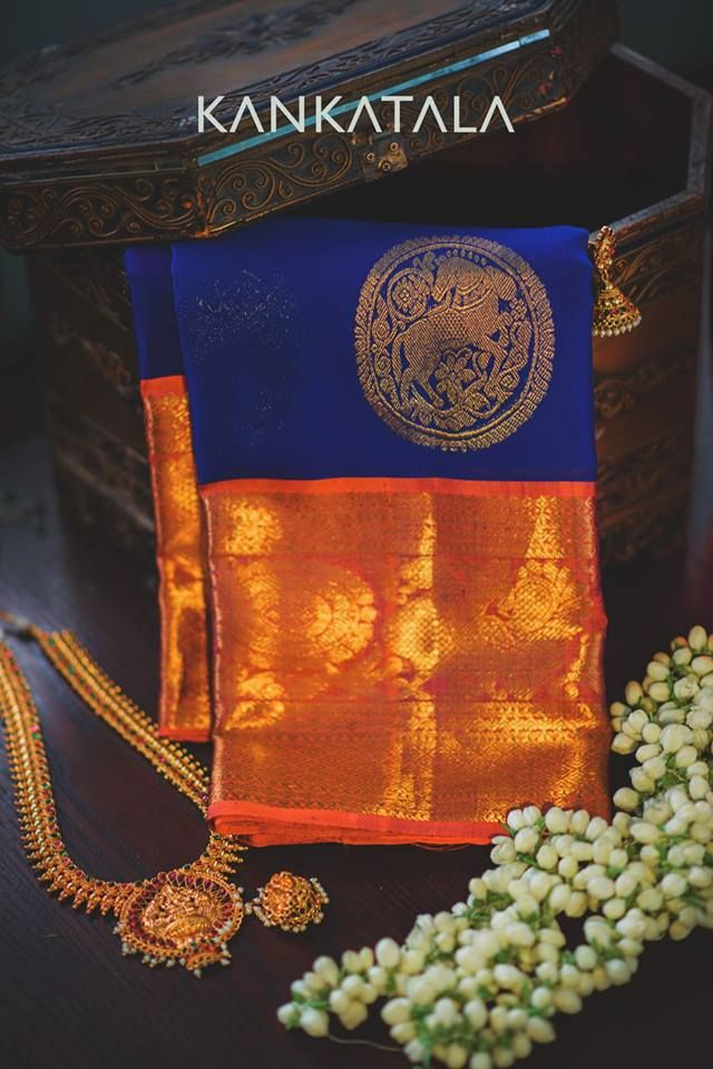 Take a look at this gorgeous blue kora saree with orange kanchi border! #kanchi #Kora #Kankatala #Sarees #Handloom