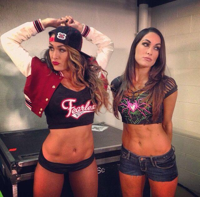 Nikki Bella with Brie Bella (dressed as AJ) Brie looks soo ...