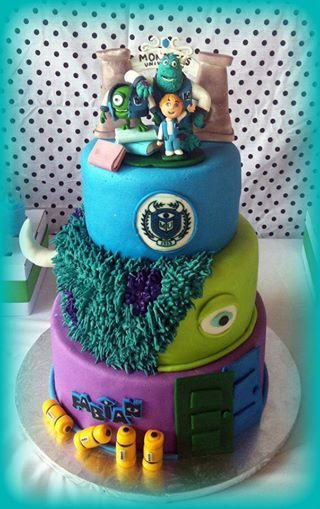 monster university cake… the little boy on top, is actually the birthday boy made out of gum paste.   how cute is that?