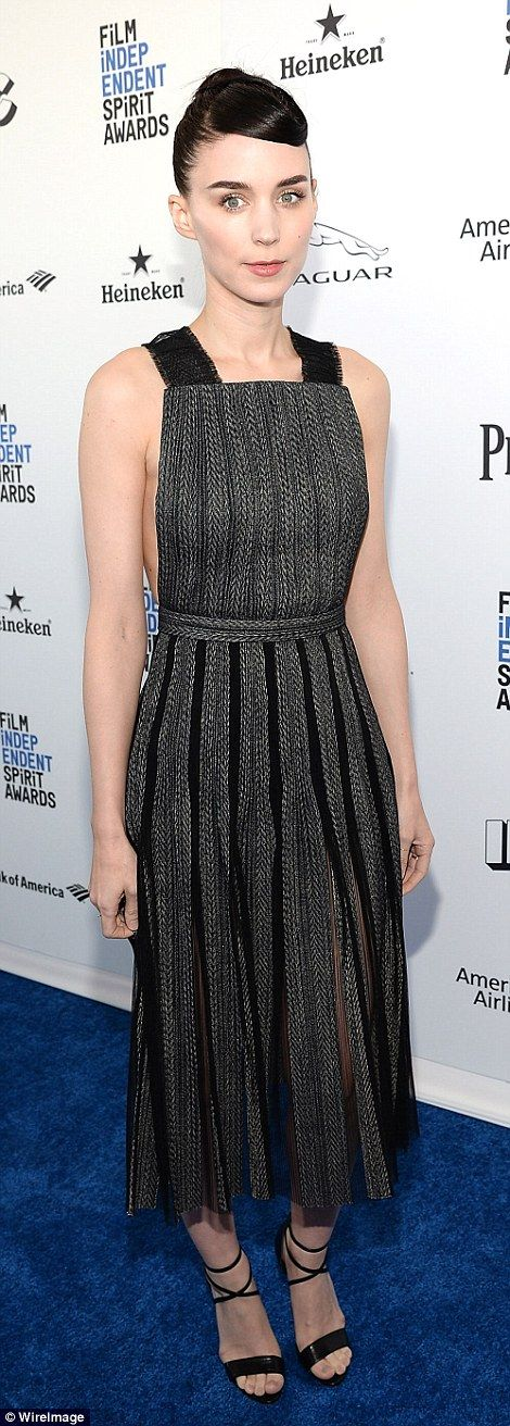Not so basic in black and grey: Rooney Mara stood out in a pleated dress with black heels ...