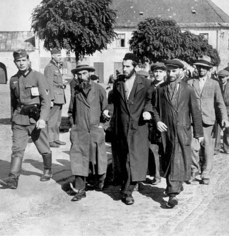 Poland, Jews being led to forced labor by German soldiers.