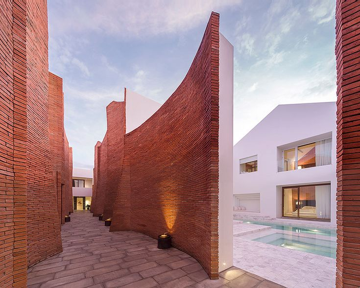 This boutique hotel for the win! Look at those curves! *whistles* -- onion sala ayutthaya boutique hotel curved brick walls white geometries thailand designboom