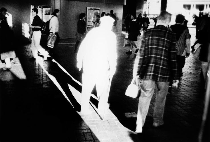 Trent Parke. AUSTRALIA. Sydney. An elderly man dressed in white walks into harsh sunlight in a tunnel under Circular Quay railway station. From Dream/Life series. 2001. Magnum Photos