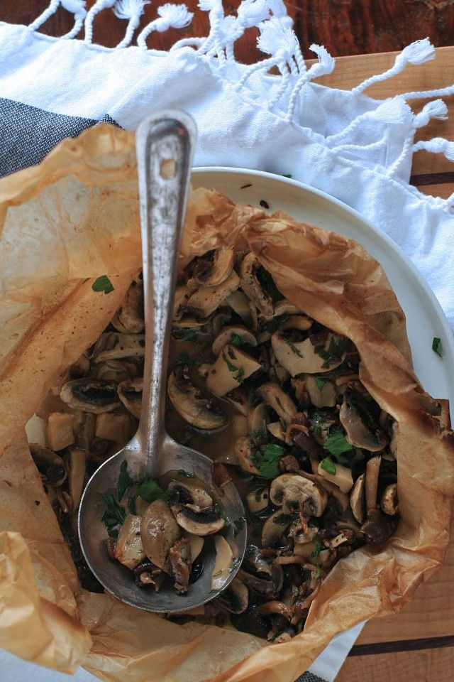 Mushrooms, butter, white wine, lemon juice and herbs baked in parchment paper. So easy and so good!