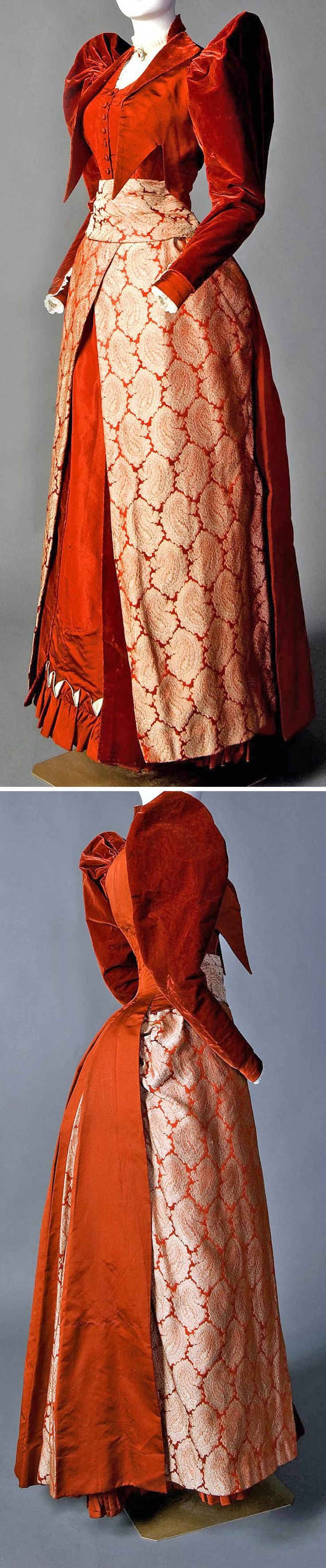 "Two-piece day ensemble, Mme. Lambele de St. Omer, New York, ca. 1891-92. Rust red silk faille, velvet,  brocade. Peaked sleeve cap identifies dress as early 1890s. It has grown as bustle has shrunk. Bodice is a ""tailor-made,"" with revers (lapels), tail, suggested waistcoat (vest),  high-collared white neck insert. Skirt falls smoothly over hips, flaring at base. Modified bustle of steel  ties built into back of skirt. Smith College Historic Clothing"