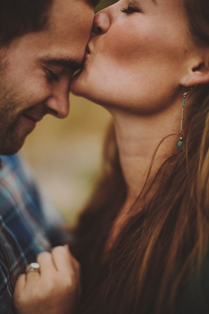 Cute photo with her kissing him and a smile on his face - also shows the ring