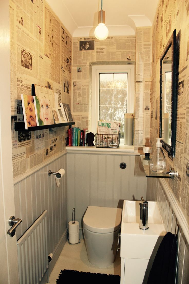 Cloakroom renovation - grey panelling and newspaper wallpaper                                                                                                                                                                                 More