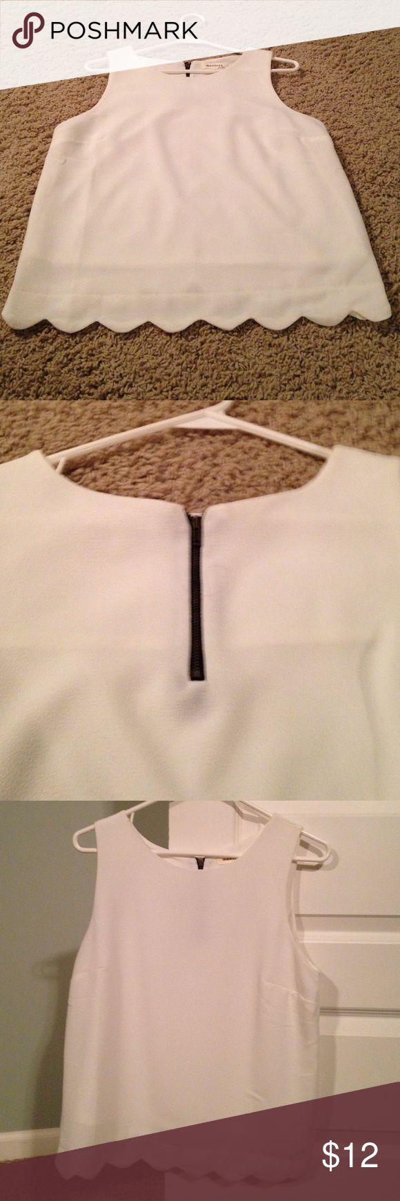 White Sleeveless Scalloped Top White Sleeveless top with scallop detail st bottom. Back has a zipper. Super cute and NWOT! Never worn Monteau Tops Tank Tops