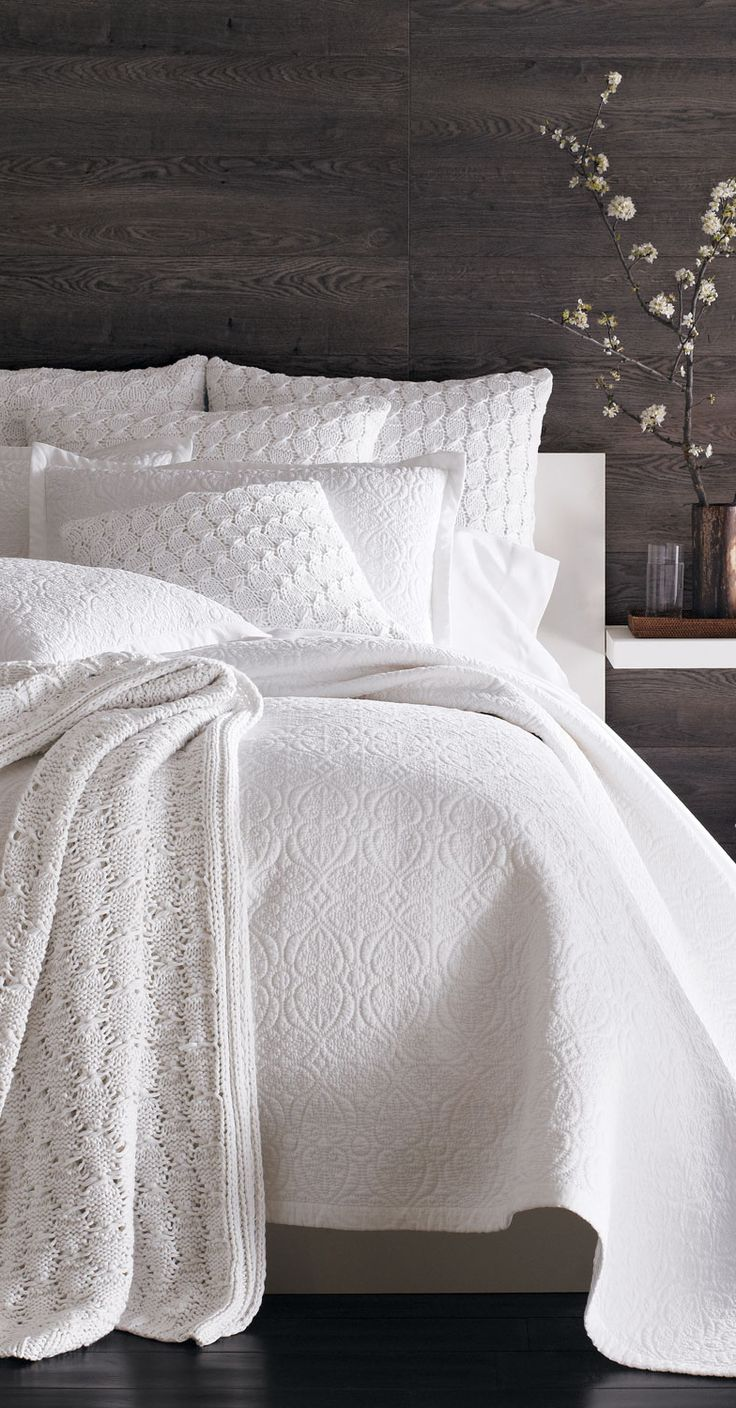 Contrast Colors For Bedroom. Exposed Wood Wall With All White Decor.  Textured White On White Bed Linens