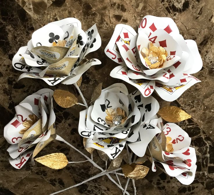 Combine fun and elegance for your Vegas wedding, event or casino party with these playing card flowers combining a touch of bling and shimmering gold leaves. These particular photos feature part of a custom order for a customer who is using these as individual flowers to be added to the arrangements for a Vegas themed 50th Anniversary/vow renewal ceremony. This listing is for 1 playing card flower, your choice of suit (hearts, spades, diamonds, clubs) and choice of standard playing cards in…