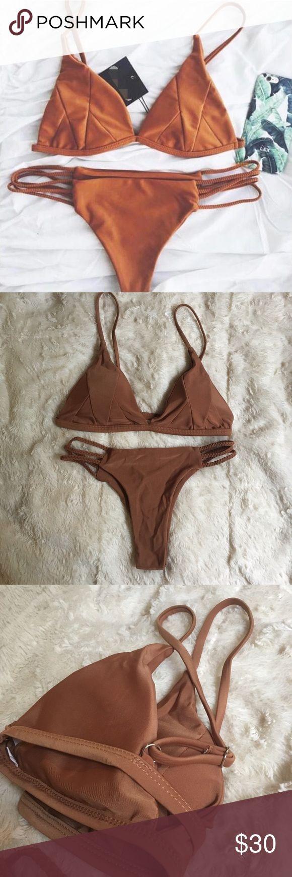 Brazilian triangle bikini Brand new Brazilian triangle bikini with no tags. Size medium. Has padding and adjustable straps! Swim Bikinis