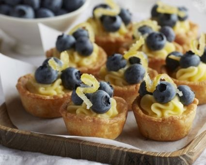 Blueberry Lemon Curd Puff Pastry Cups Recipe  For the pastry cups:      1 cup all-purpose flour     Pinch of salt     7 tablespoons unsalted butter, cut into pieces, at room temperature, plus more for the pans     3 ounces cream cheese, cut into tablespoons, at room temperature