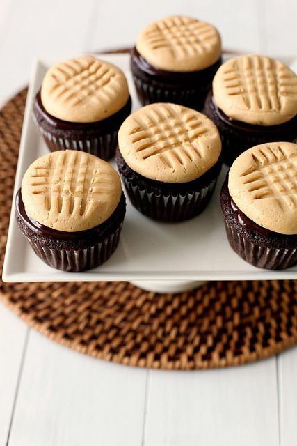 """chocolate cupcakes with peanut butter cookie frosting –Soooo…yeah. A perfect chocolate cupcake topped with ganache and """"frosting"""" that looks like a peanut butter cookie, has a texture similar to the filling of a buckeye, and tastes amazing. That's everything you need to know. Make them this weekend. Yes!"""